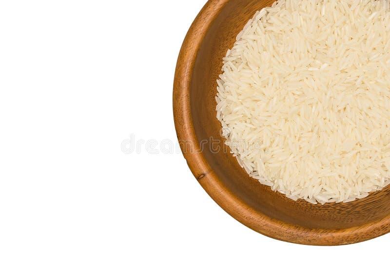 在白色背景的白色长的米,未煮过的未加工的谷物特写镜头 免版税图库摄影