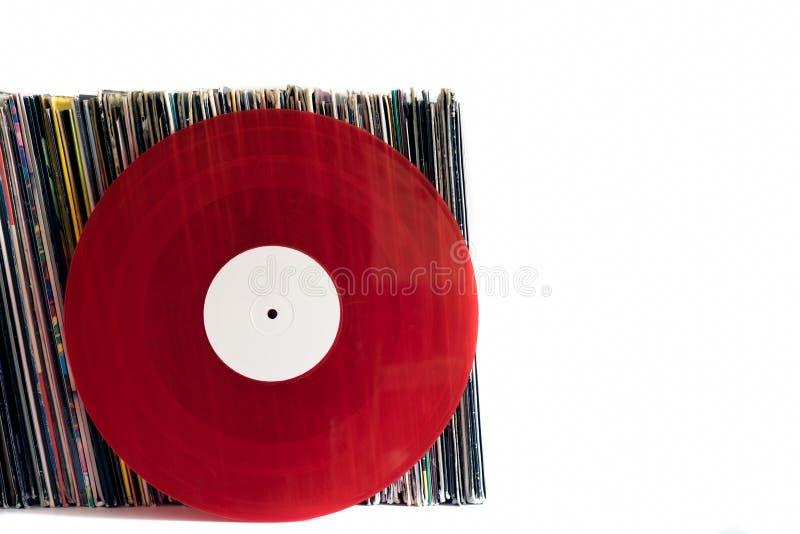 在白色背景的红色唱片 库存照片