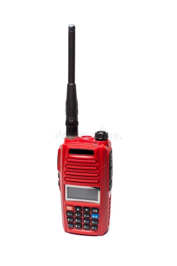 在白色背景的红色携带无线电话 免版税库存照片