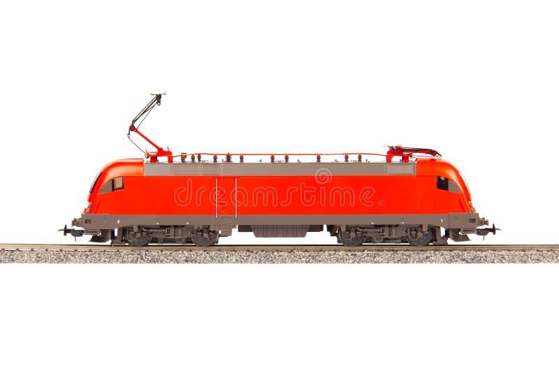 在白色背景的红色电力机车 库存照片