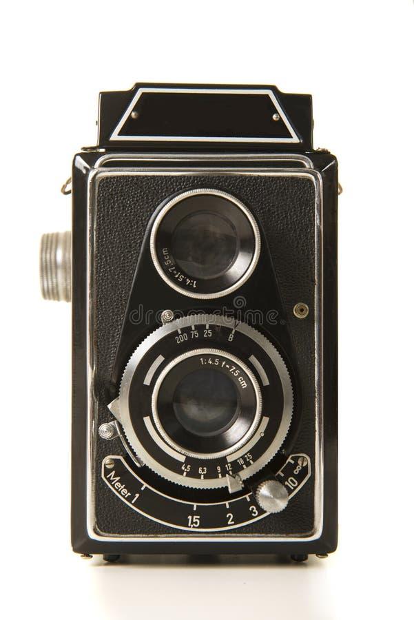 在白色背景的老古色古香的黑照片照相机 免版税库存图片