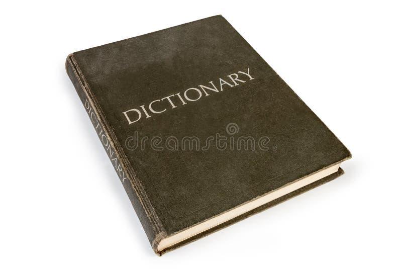 在白色背景的老精装书字典 免版税库存照片