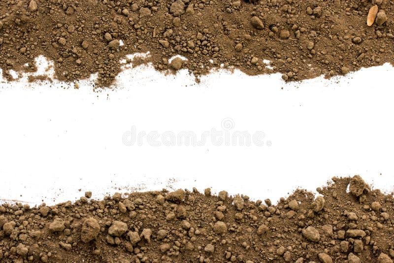 在白色背景的肮脏的地球 免版税库存照片