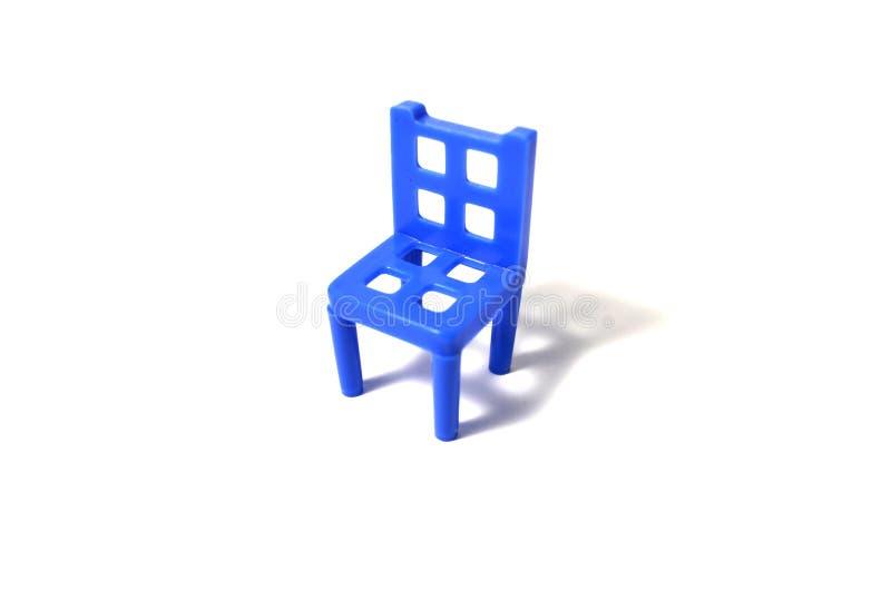 在白色背景的蓝色椅子 库存照片