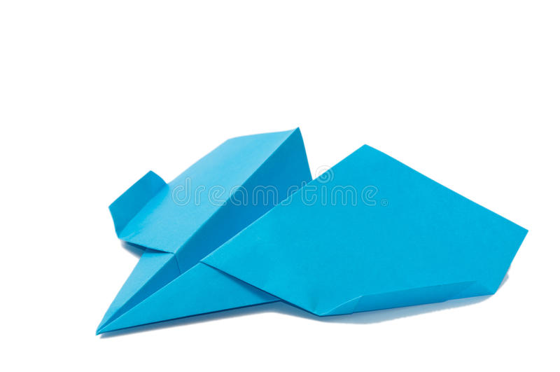 在白色背景的蓝色origami飞机 免版税库存照片