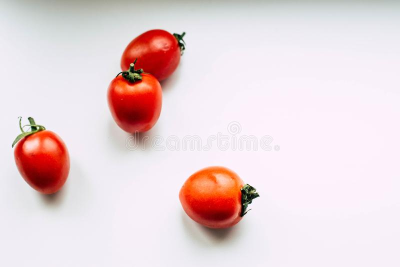 在白色背景的蕃茄 库存照片