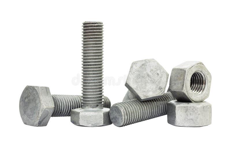 在白色背景的螺栓、螺柱和坚果孤立 由铁和坚果做的螺栓涂用锌为保护腐蚀 免版税库存图片