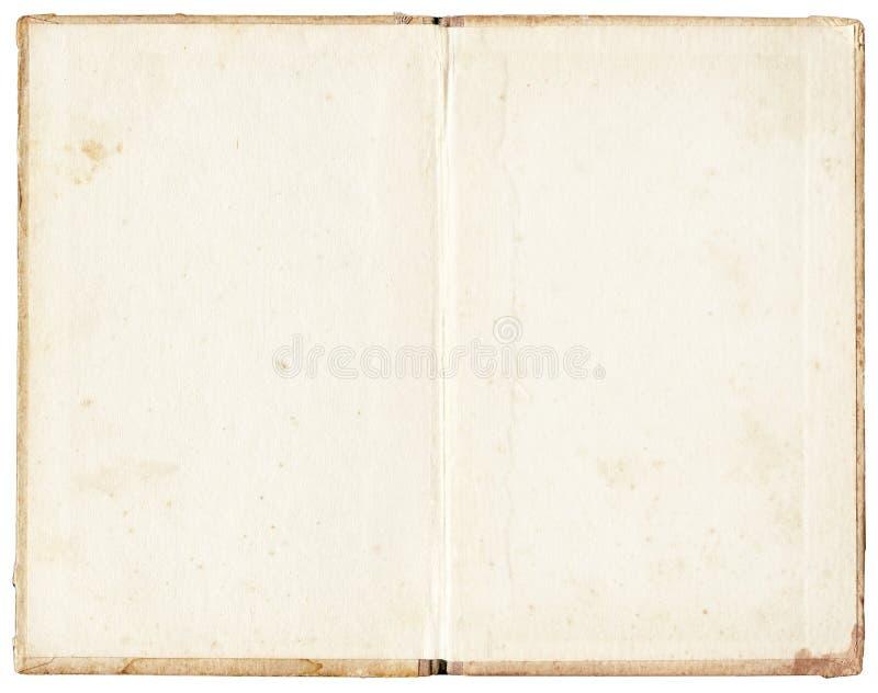 在白色背景的被弄脏的开放书 免版税库存图片