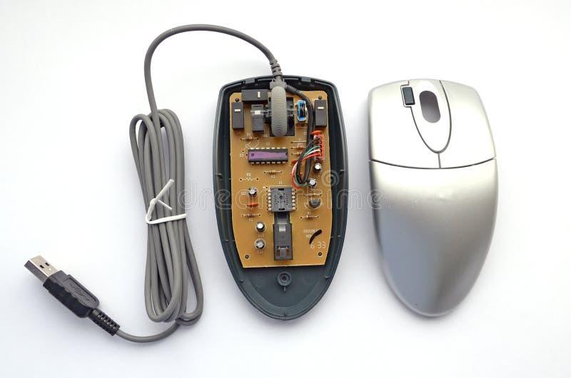 在白色背景的被拆卸的光学计算机老鼠 免版税库存照片