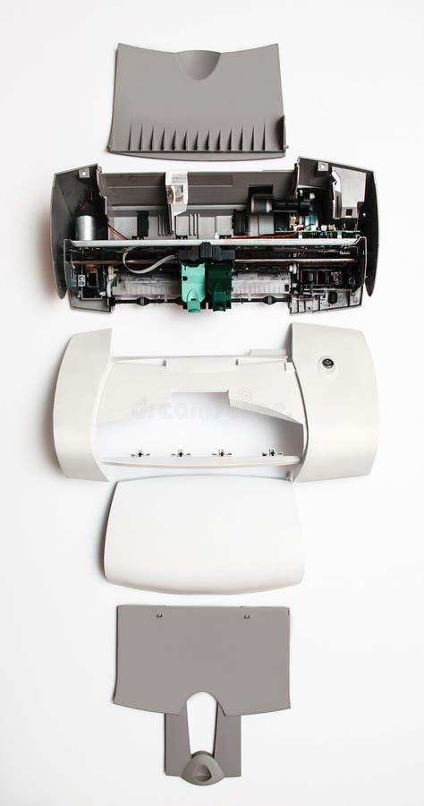 在白色背景的被拆卸的打印机 免版税库存图片