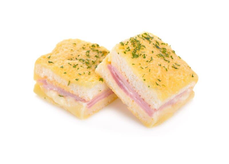 在白色背景的被烘烤的微型三明治 库存照片
