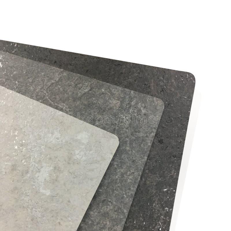 在白色背景的被碾压的灰色石纹理 库存照片