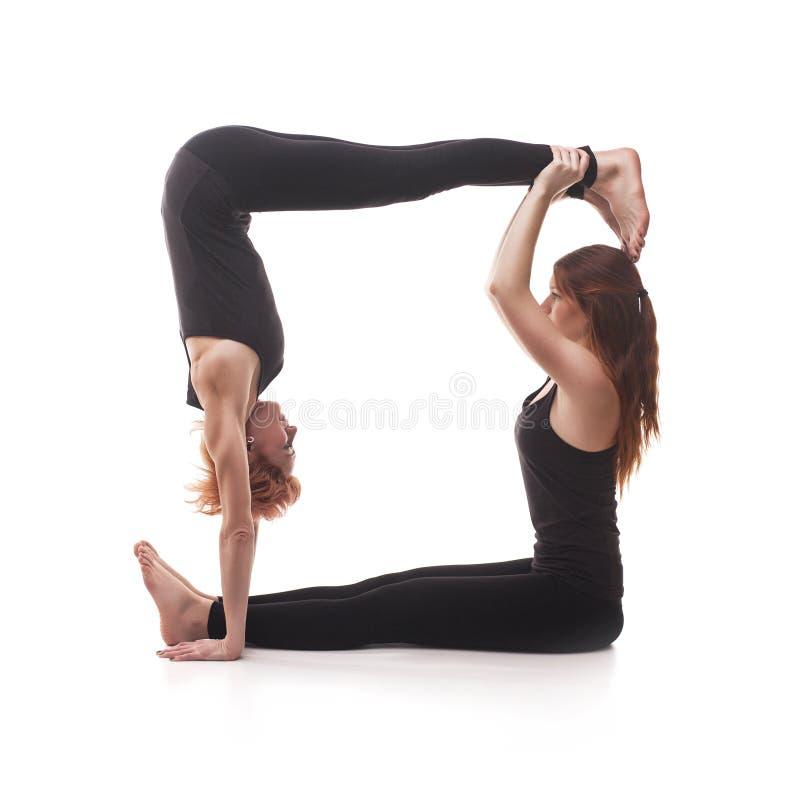 在白色背景的被配对的瑜伽 图库摄影
