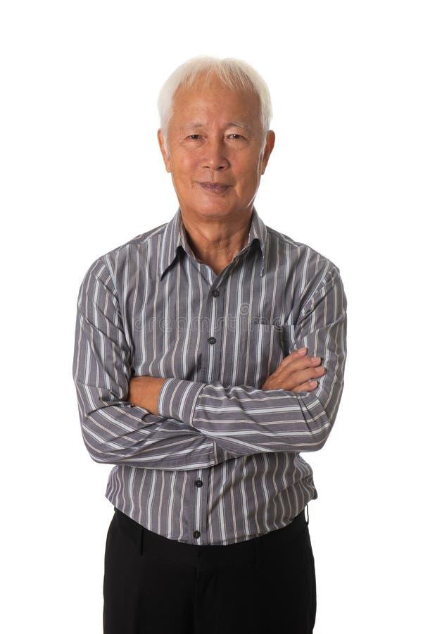 在白色背景的资深亚洲商人 免版税库存照片