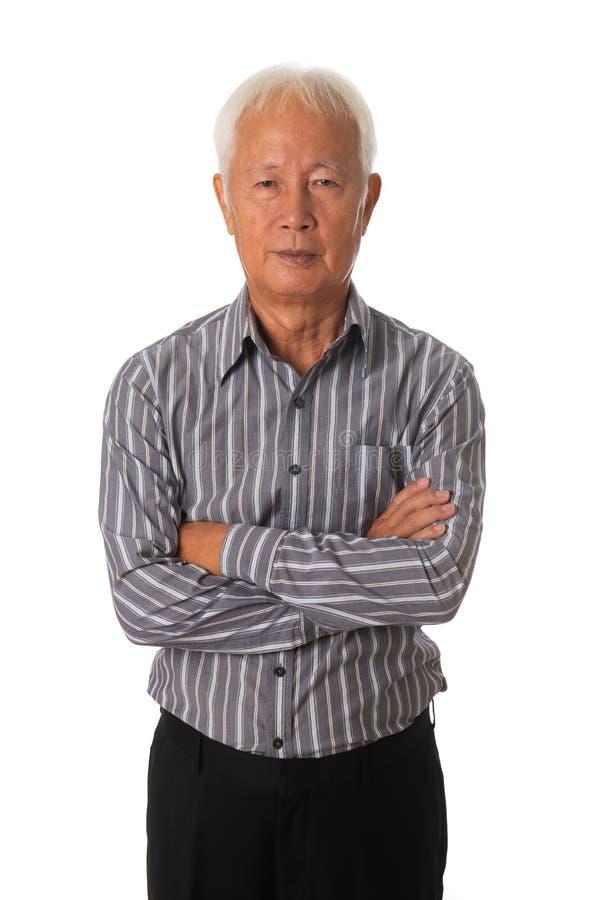 在白色背景的资深亚洲商人 免版税图库摄影