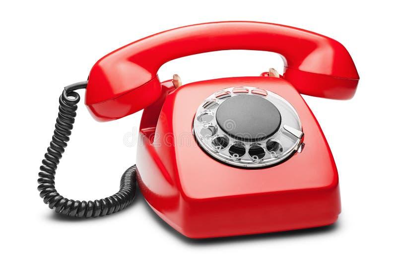 在白色背景的输送路线红色电话 库存图片