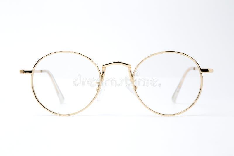 在白色背景的金经典圆的玻璃 免版税库存图片