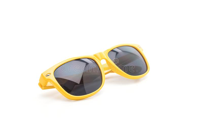 在白色背景的黄色太阳镜 库存图片