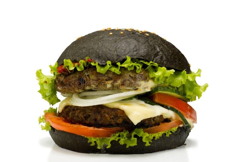 在白色背景的黑汉堡 库存照片