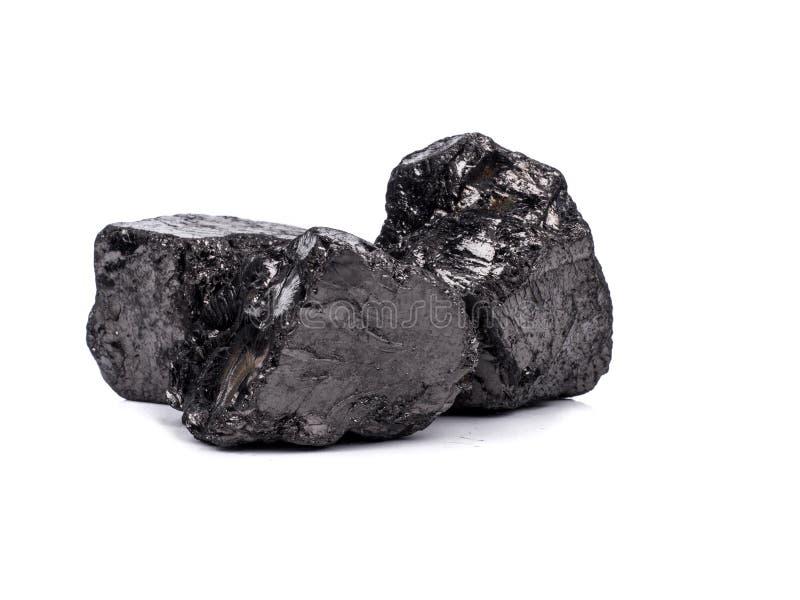 在白色背景的黑沥青煤 库存照片