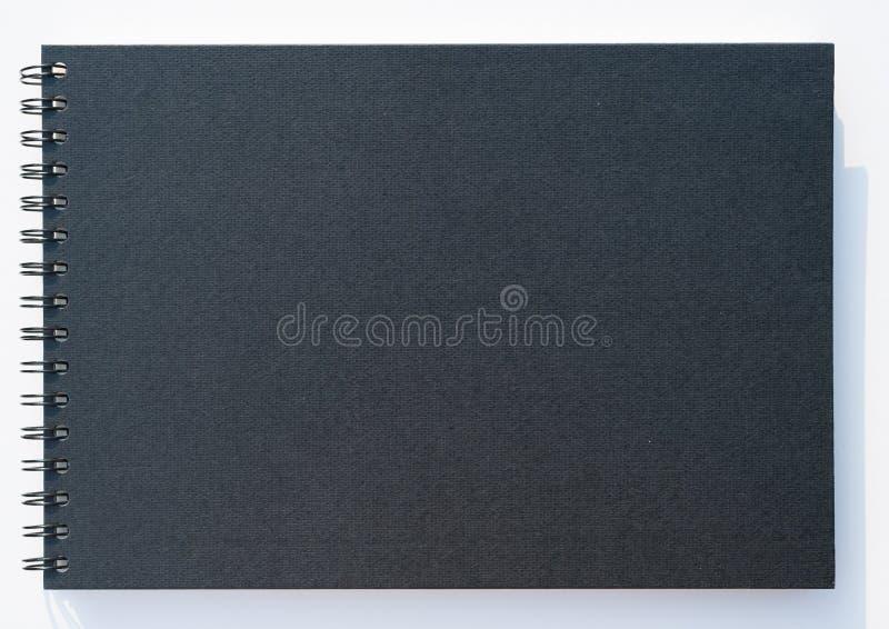 在白色背景的黑盖子图画本孤立 免版税图库摄影