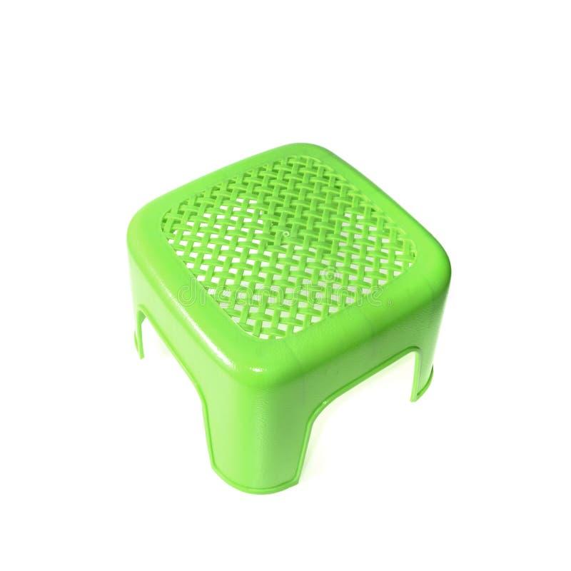 在白色背景的婴孩绿色塑料凳子 免版税库存照片