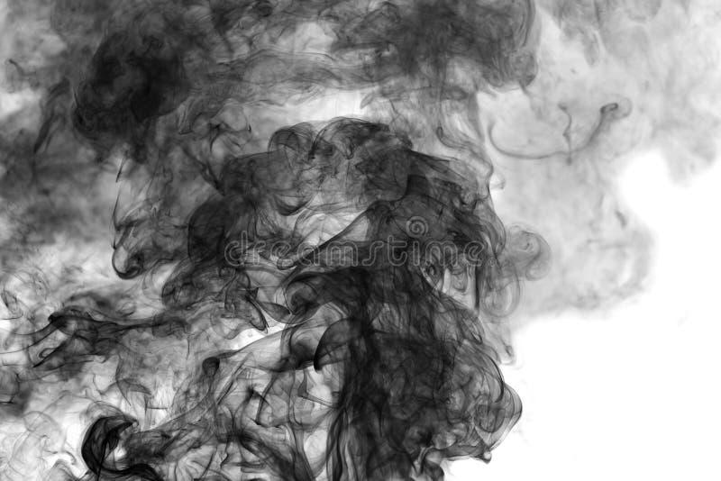 在白色背景的黑烟 免版税库存照片