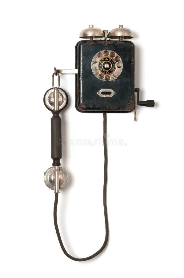 在白色背景的黑老墙壁电话 免版税库存图片