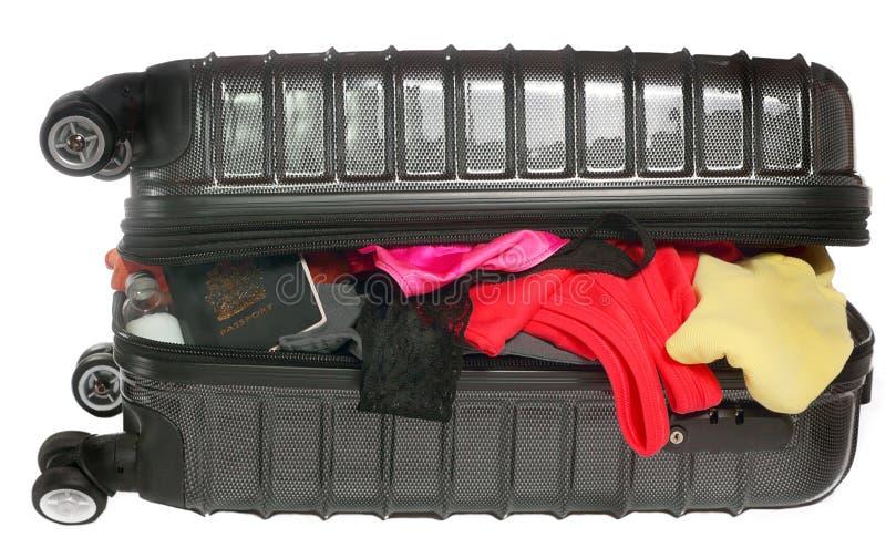 在白色背景的Overpacked手提箱 免版税库存照片