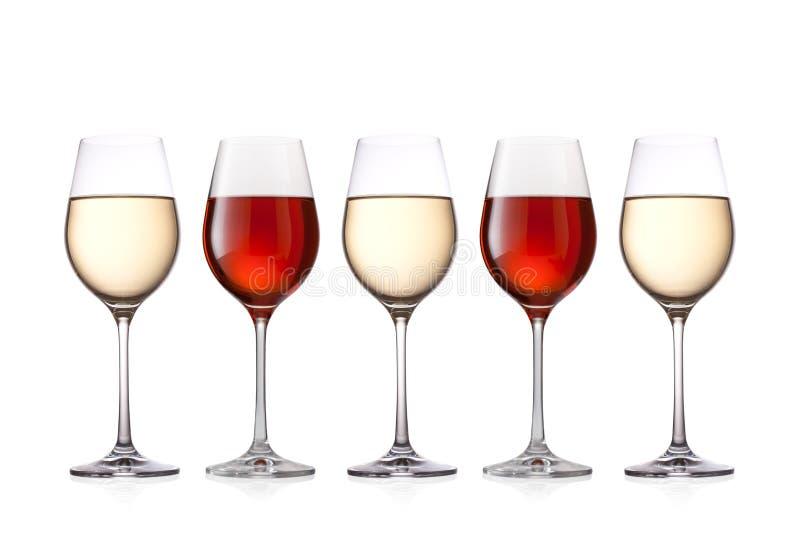 在白色背景酒隔绝的杯 免版税库存图片