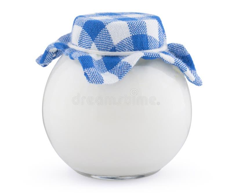 在白色背景酸性稀奶油隔绝的古板的玻璃瓶 免版税图库摄影