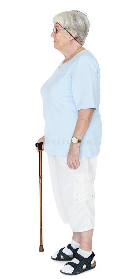 在白色背景隔绝的一名年长妇女的旁边画象 免版税库存照片