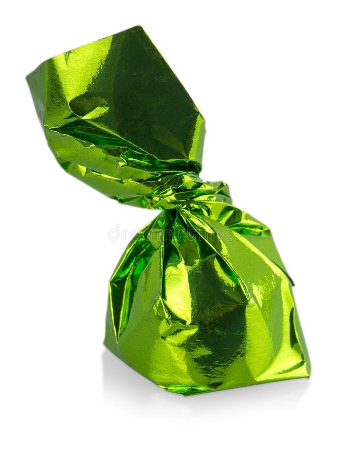 在白色背景隔绝的一唯一五颜六色的糖果关闭 免版税库存图片