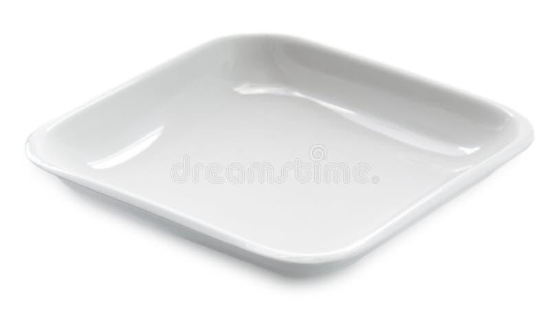 在白色背景隔绝的一块空的方形的板材 库存照片