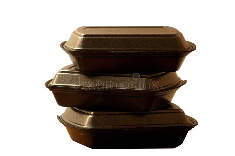 在白色背景隔绝的三个黑用餐的箱子 库存图片