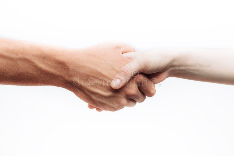在白色背景隔绝的两个成功的商人握手,做广告的,发短信给插入 免版税库存图片