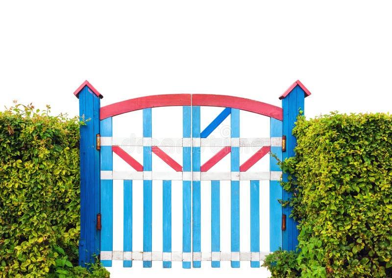 在白色背景隔绝的五颜六色的木花园大门 免版税库存图片