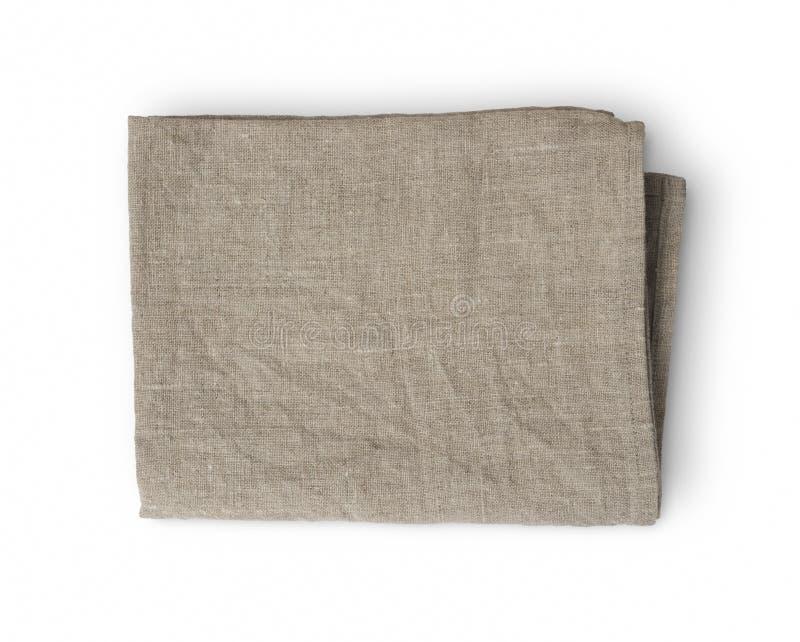 在白色背景隔绝的使用的弄皱的被折叠的亚麻制洗碗布 库存照片