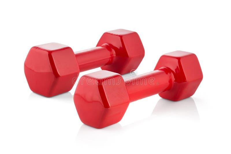 在白色背景隔绝的健身的红色哑铃 图库摄影