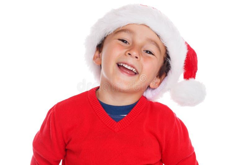 在白色背景隔绝的儿童孩子男孩圣诞节圣诞老人项目微笑的愉快 免版税库存图片
