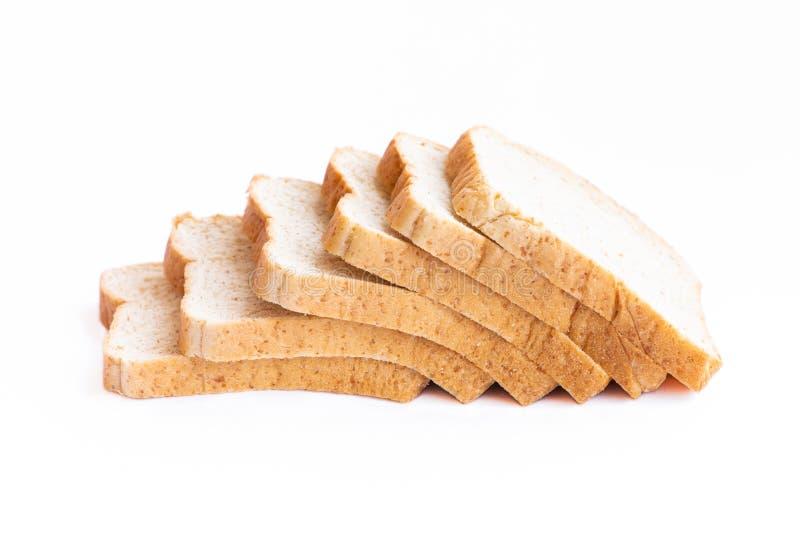 在白色背景隔绝的切的面包 库存照片
