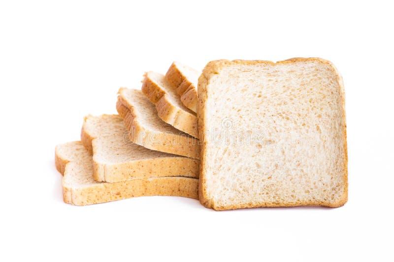 在白色背景隔绝的切的面包 免版税库存图片