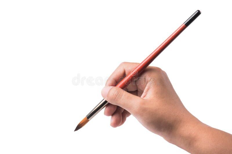 在白色背景隔绝的右手举行水彩刷子 图库摄影