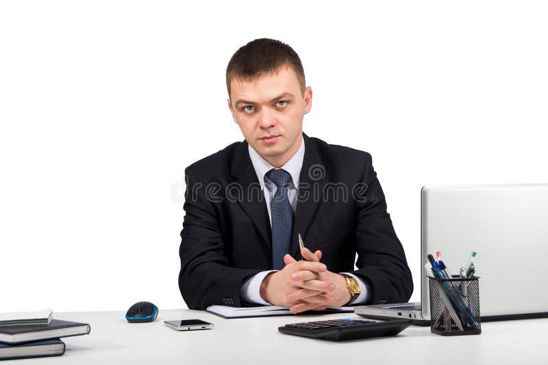 在白色背景隔绝的商人与文件一起使用和膝上型计算机 库存照片