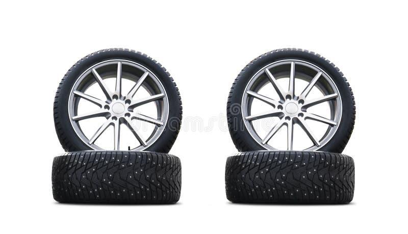 在白色背景隔绝的四个新的悦目防滑轮胎 一套散布的冬天车胎 一套轮子和轮胎pac 免版税库存照片