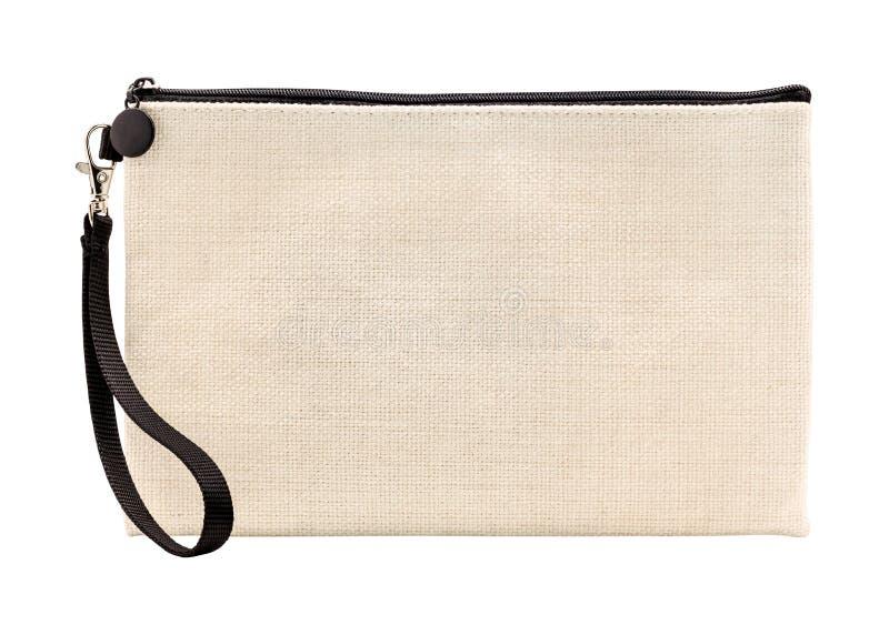 在白色背景隔绝的垂悬的织品袋子 由亚麻制织品材料做的拉链袋子 r 图库摄影