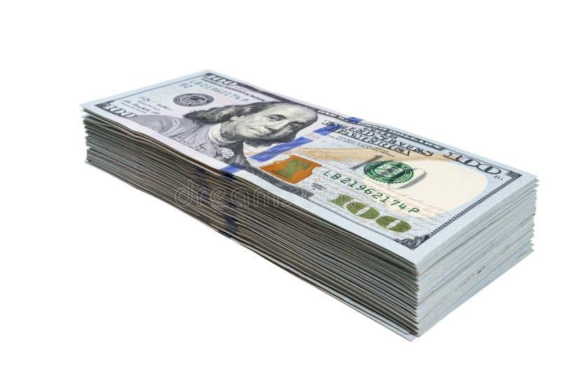 在白色背景隔绝的堆一百元钞票 堆现金金钱在一百美元钞票 一百个d堆  库存图片