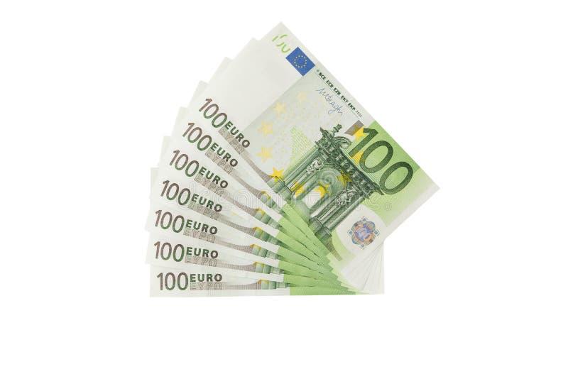 在白色背景隔绝的堆一百张欧洲钞票 免版税库存照片