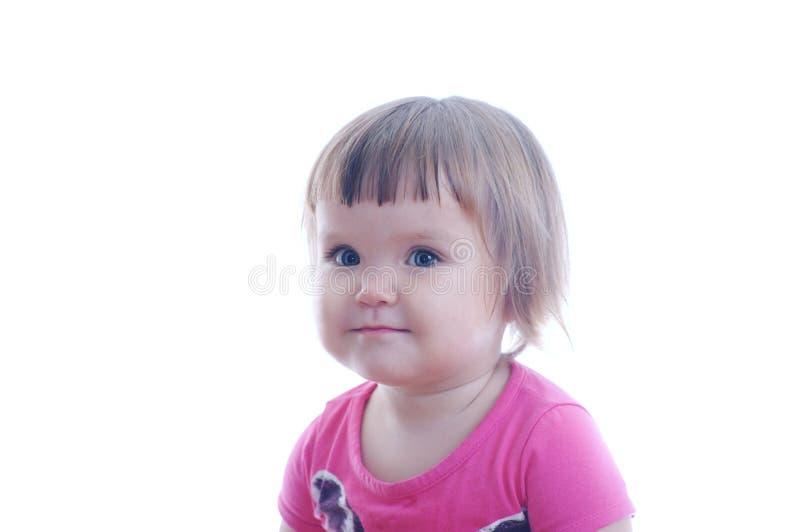 在白色背景隔绝的小的女婴画象 愉快的微笑的逗人喜爱的可爱的童颜 免版税库存照片