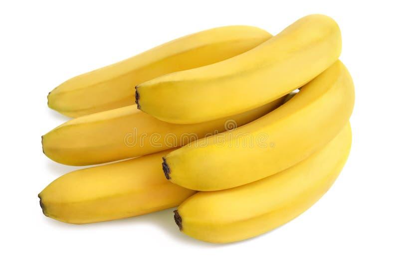 在白色背景隔绝的成熟束黄色香蕉 免版税库存照片